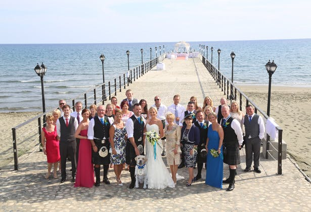 The newlyweds with their family and friends in Cyprus