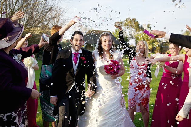 Guests throwing confetti to celebrate the marriage
