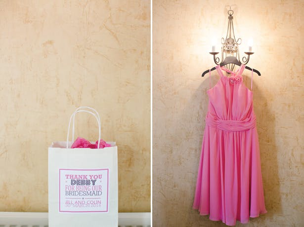 Bridesmaids gift and coral pink knee length dresses with a draped halter neck.