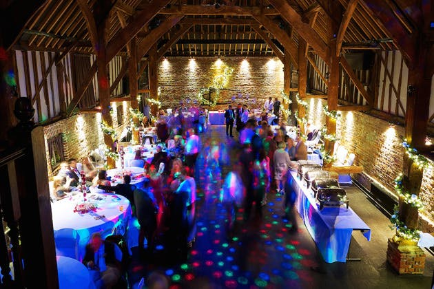 Evening wedding reception at Cooling Castle Barn