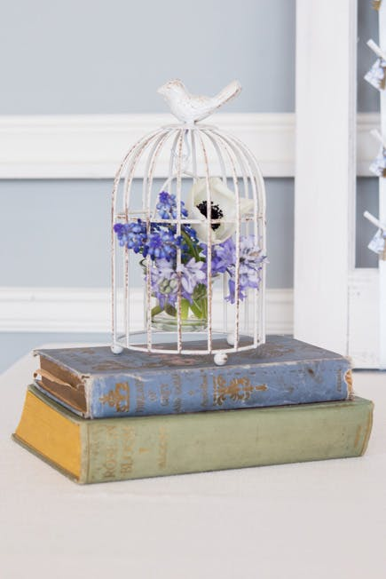 Blue and White Vintage Birdcage Centrepiece | Confetti.co.uk