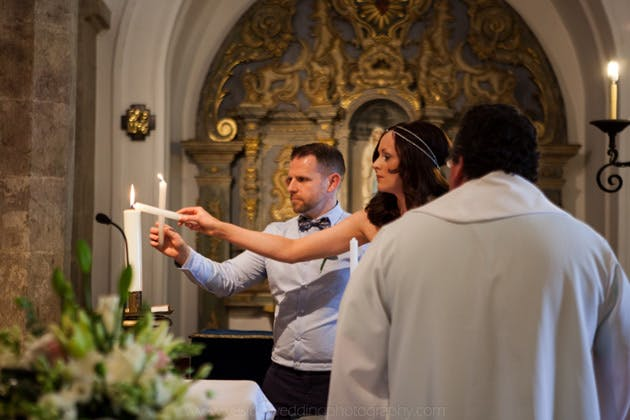The bride and groom lighting candles during the ceremony