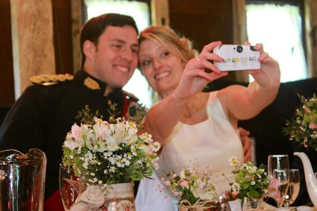 Newlyweds taking a selfie