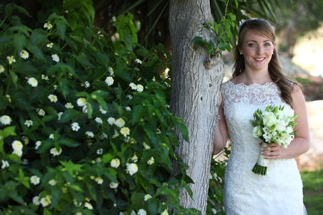 Bride in her lace Justin Alexander dress