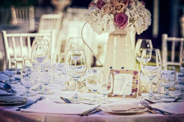 Ivory and pink rose wedding centrepiece