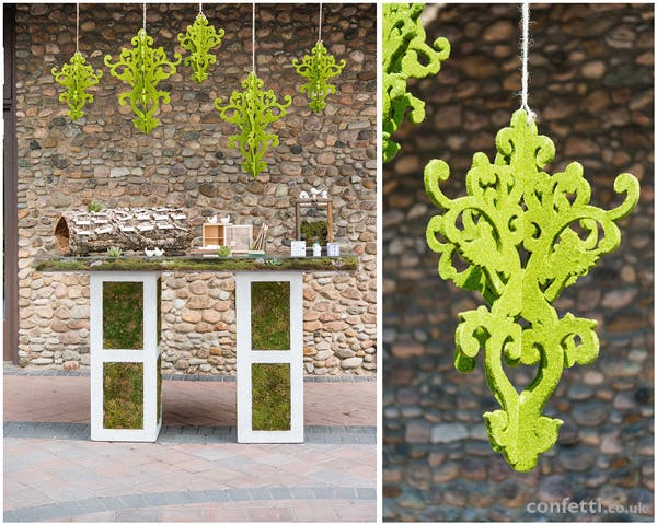 Woodland themed wedding table with moss chandeliers