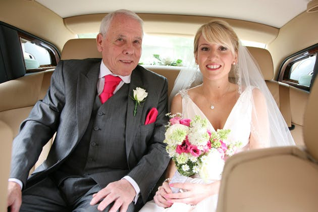Bride with her father in the wedding car on their way to the wedding ceremony |Confetti.co.uk