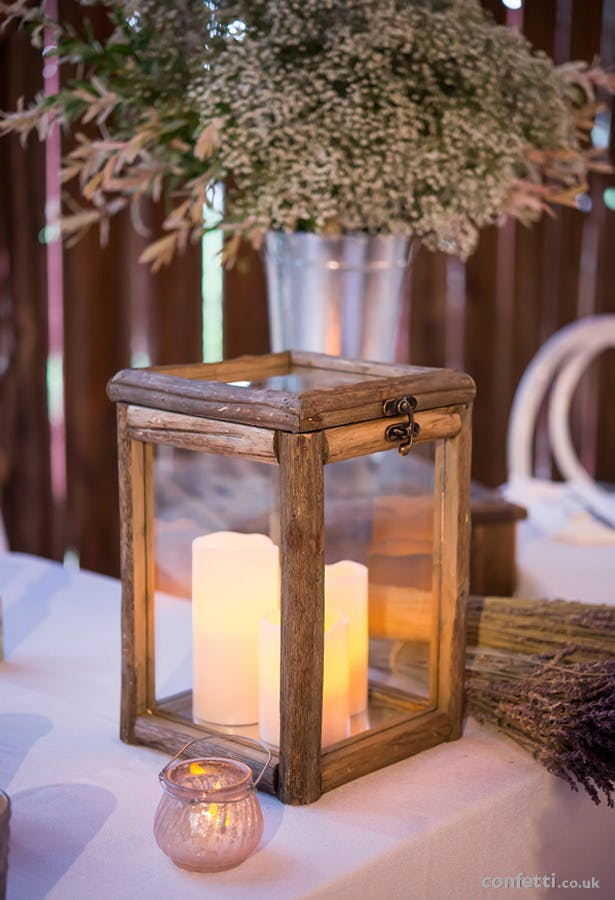 Woodland, nature inspired wedding centrepiece with pillar candles | Confetti.co.uk