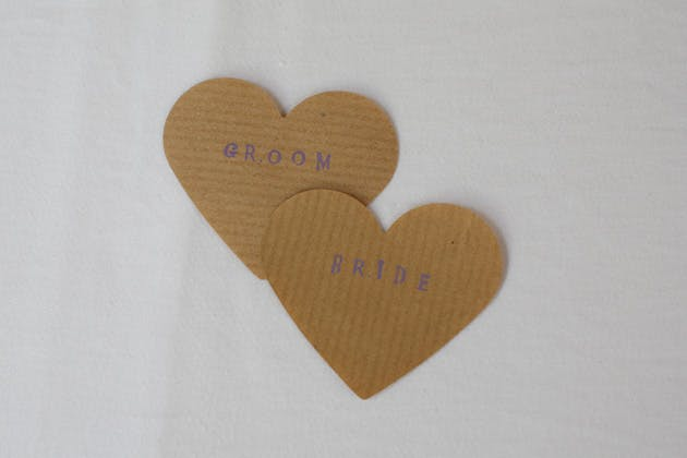 Rustic heart with bride and groom stamped | Confetti.co.uk