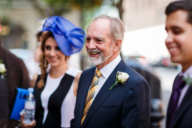 Bride's father waiting for her at the ceremony in a blue suit  | Confetti.co.uk