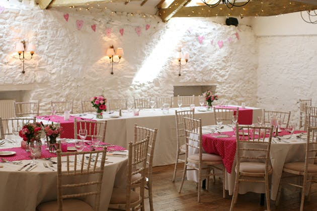 Sweet pink flowers and polk dot wedding reception decor | Confetti.co.uk