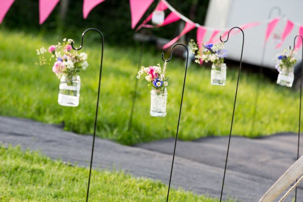 Jars with wildflowers leading the way to the venue | Confetti.co.uk
