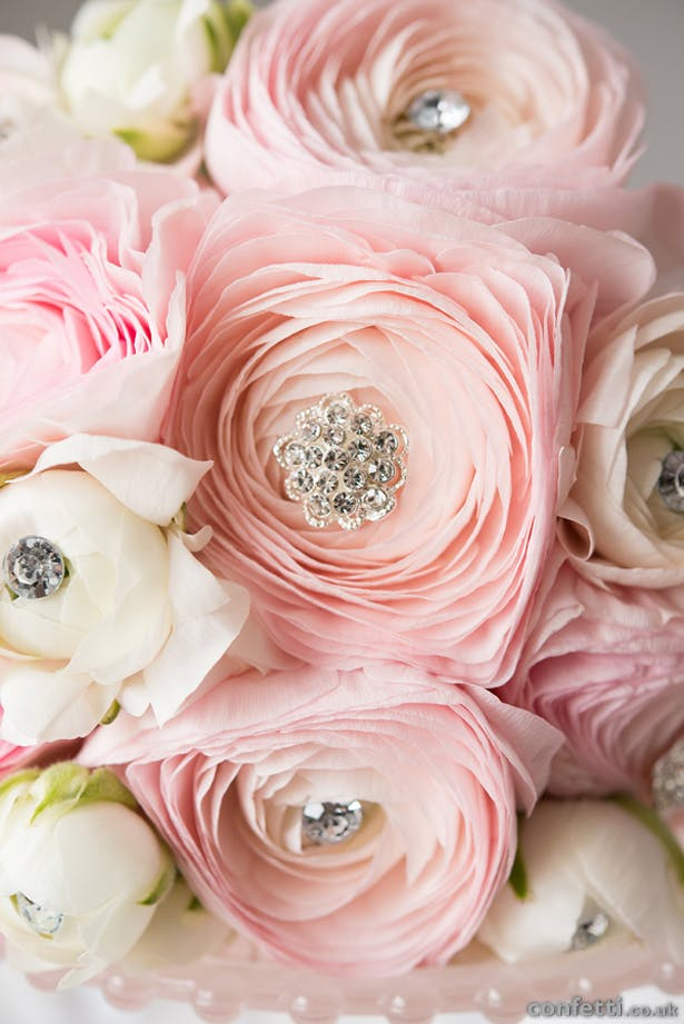 Classic pale pink roses with crystal pin centres | Confetti.co.uk
