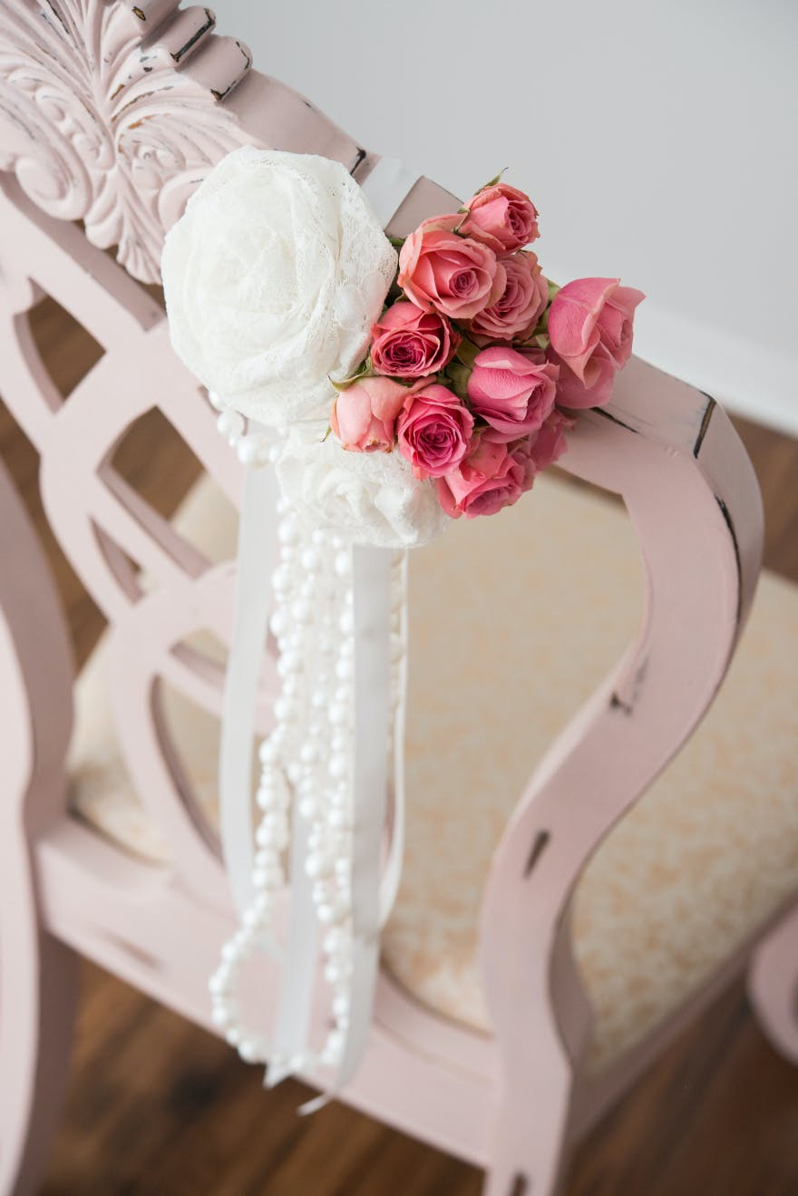 Pink and Ivory Pearls and Lace Chair Decoration | Confetti.co.uk