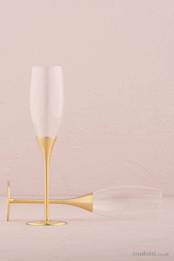 Venice Gold Toasting Flutes from www.confetti.co.uk add opulence to an art deco champagne bar reception.