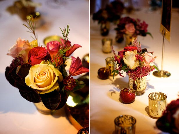 Styling Autumn Wedding | Real Wedding Autumn Wedding Flora Centrepieces | Image courtesy of Henry Wells |Pink, Ivory Roses with Berries and Gold Autumn Mini Centrepieces | Gold Candle Holders |Confetti.co.uk