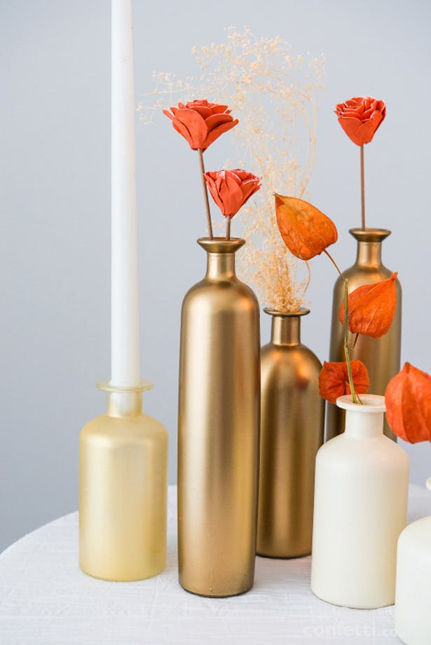 Autumnal gold bottles and flowers | Confetti.co.uk