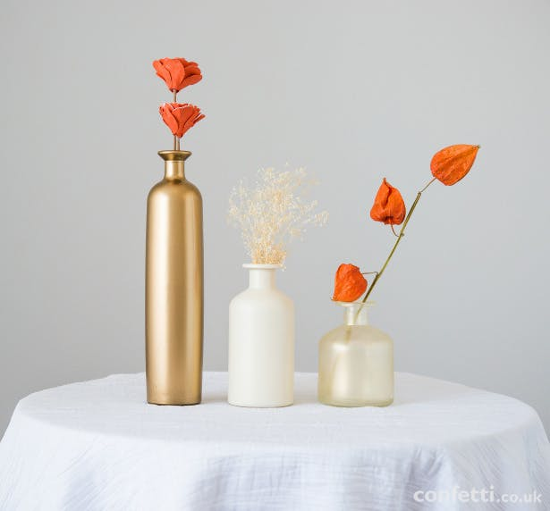 Vary the look of your centrepieces by grouping and arranging | Confetti.co.uk