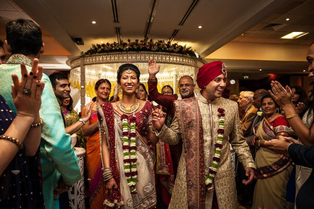 The newlyweds leaving the mandap| Traditional Hindu wedding | Confetti.co.uk