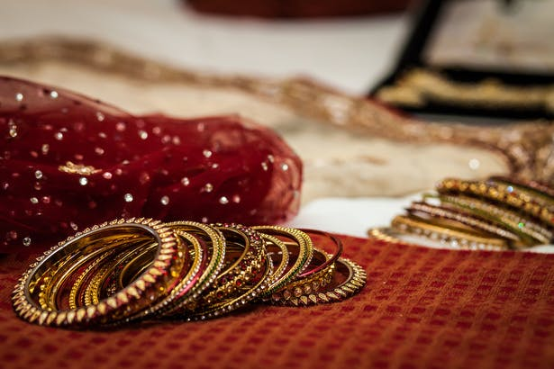 Indian red and gold bridal bangles | Confetti.co.uk