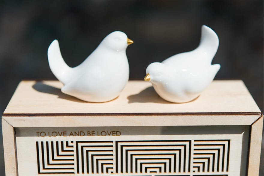 Ceramic Birds Gold Accent as Decorations - Ceramic white and gold birds wedding decoration perched on a cubist keepsake box | Confetti.co.uk