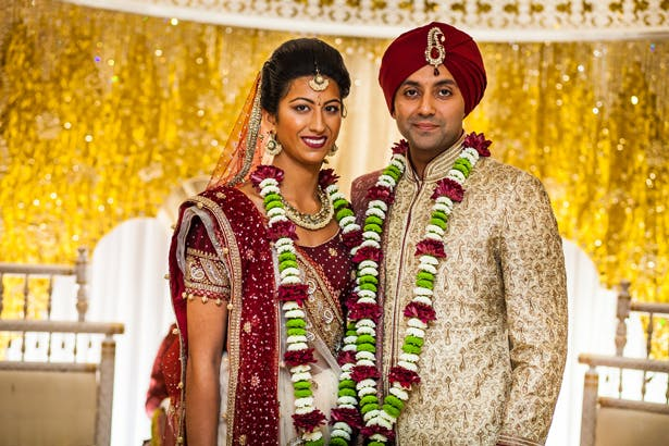 Devina and Shiv's Real Wedding | Traditional Indian Wedding Ceremony in red and gold | Confetti.co.uk