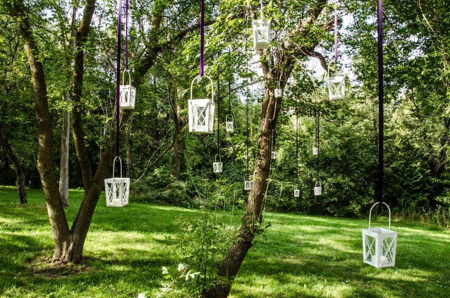 Lanterns Hanging from Tree Branches | Confetti.co.uk