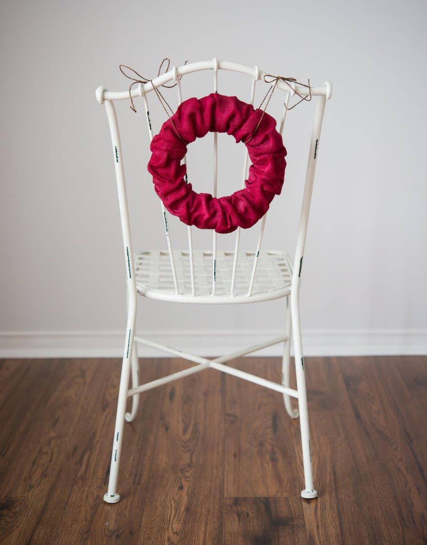 Red Wreath Chair Back - Burlap wreath as a chair back decoration   Confetti.co.uk