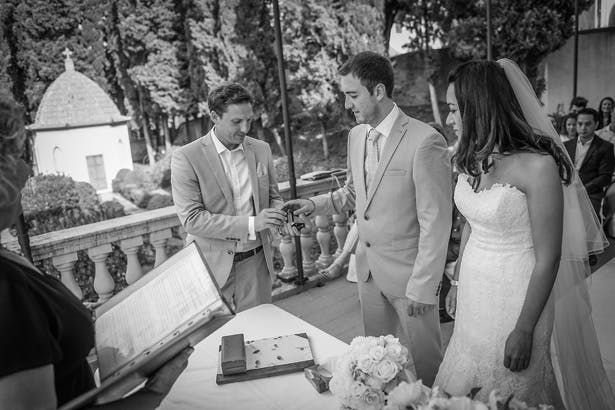 Groom taking the wedding rings from his best man | Morgan and James Real Wedding By Infinity Weddings | Confetti.co.uk