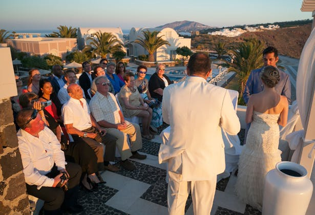 Guests watching the ceremony   Dasha and Steve's Real Wedding In Greece   Marryme in Greece   Confetti.co.uk