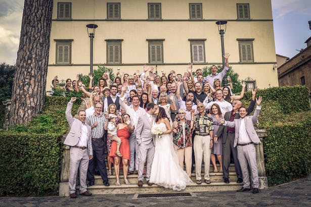 Group shot of the bride and groom with their wedding guests | Morgan and James Real Wedding By Infinity Weddings | Confetti.co.uk