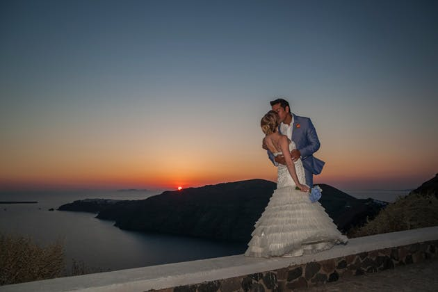 The bride and groom kissing by the ocean at sunset   Wedding portfolio by Creative Shotz   Dasha and Steve's Real Wedding In Greece   Marryme in Greece   Confetti.co.uk