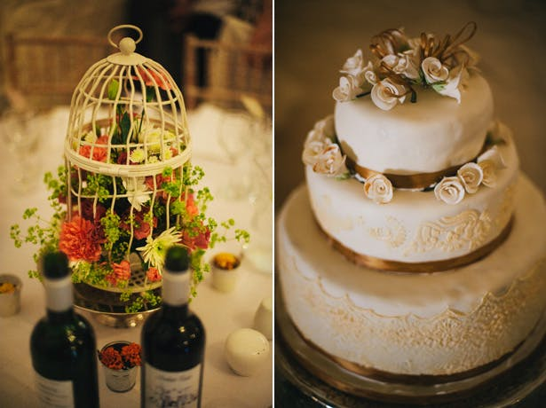 White birdcage with vivid flowers centrepiece | 3 Tier ivory wedding cake | Francesca & Arun's Fusion Real Wedding | Confetti.co.uk