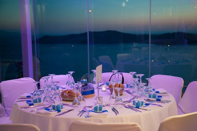 Blue and white wedding table decor   Tiffany blue boxed wedding favours   Wedding reception at the Pantheon villas Santorini   Dasha and Steve's Real Wedding In Greece   Marryme in Greece   Confetti.co.uk