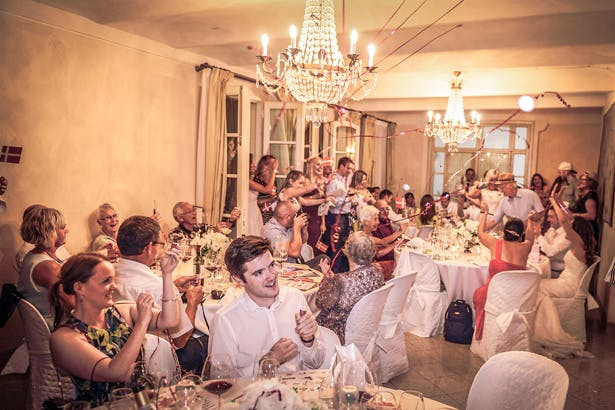 Guests celebrating the wedding with party poppers | Wedding reception at Villa Bucciano , Tuscany | Morgan and James Real Wedding By Infinity Weddings | Confetti.co.uk