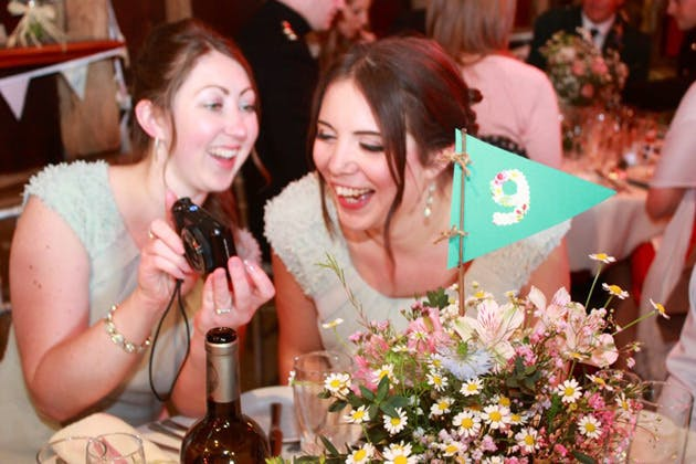 Wedding Worth Selfie | Bridesmaids laughing at pictures on their digital camera | Confetti.co.uk