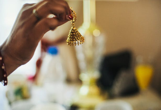 Gold Asian earring | Bridal accessory | Francesca & Arun's Fusion Real Wedding | Confetti.co.uk