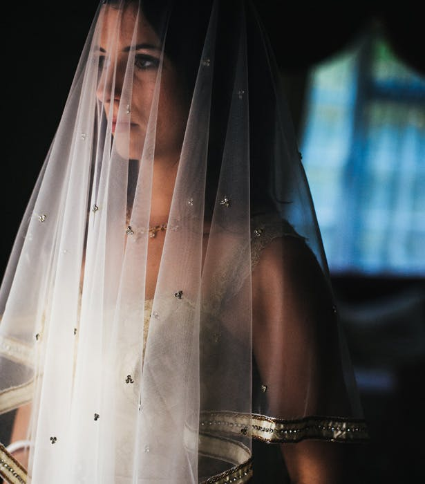 Bride in her gold wedding dress and gold veil | Francesca & Arun's Fusion Real Wedding | Confetti.co.uk