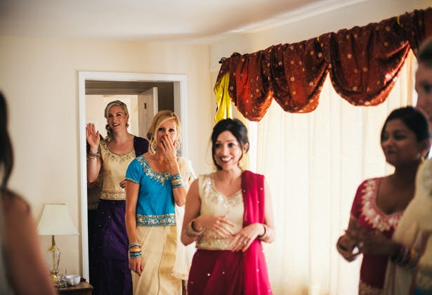 Bridesmaids in traditional Asian attire  | bridesmaids seeing the bride for the first time | Francesca & Arun's Fusion Real Wedding | Confetti.co.uk