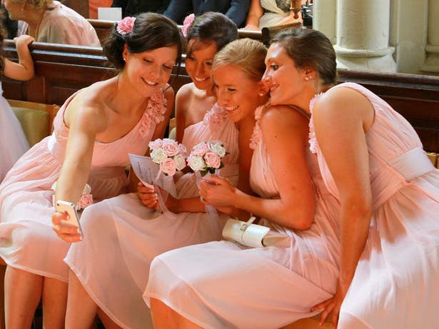 Wedding Worthy Selfie | Bridesmaids taking a selfie at the ceremony | Confetti.co.uk