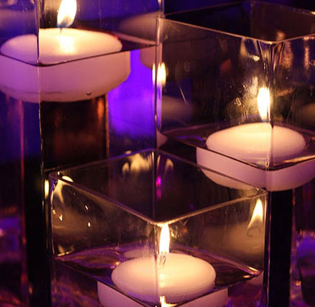Floating candles in water | First Christmas as Mr and Mrs | Confetti.co.uk