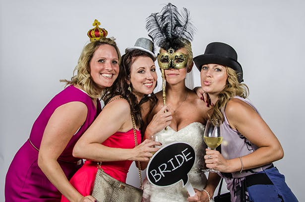 Wedding Worth Selfie | Bride and her bridesmaids having fun with vintage props | Confetti.co.uk