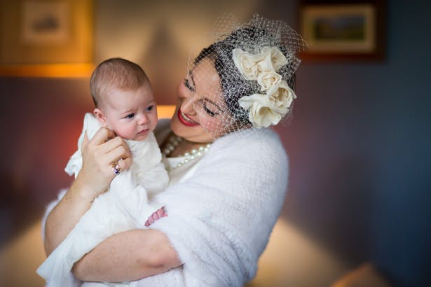 Bride with her flower girl| Abigail and Chris's Real Christmas Wedding | Confetti.co.uk