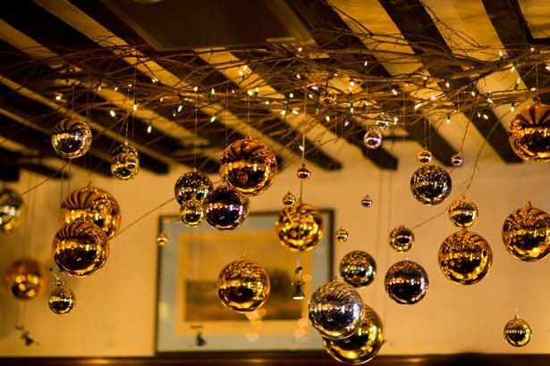 Gold Christmas Baubles | Abigail and Chris's Real Christmas Wedding | Confetti.co.uk