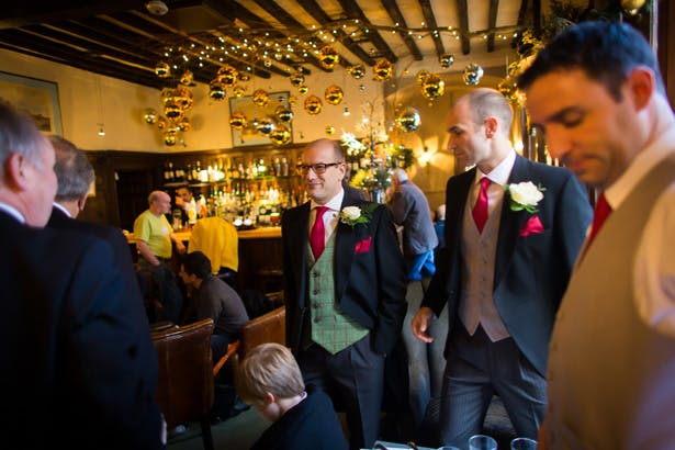 Grooms and groomsmen having a drink before the ceremony | Abigail and Chris's Real Christmas Wedding | Confetti.co.uk
