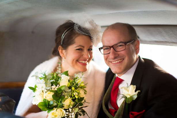 The newlyweds leaving the church | Abigail and Chris's Real Christmas Wedding | Confetti.co.uk