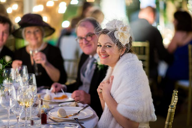 Bride enjoying the wedding breakfast | Abigail and Chris's Real Christmas Wedding | Confetti.co.uk