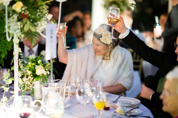 Bride and her wedding guests toasting the marriage | Abigail and Chris's Real Christmas Wedding | Confetti.co.uk