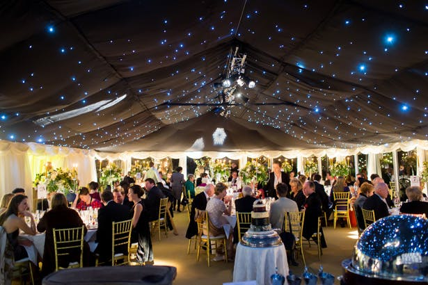 Wedding marquee with black star cloth | Abigail and Chris's Real Christmas Wedding | Confetti.co.uk
