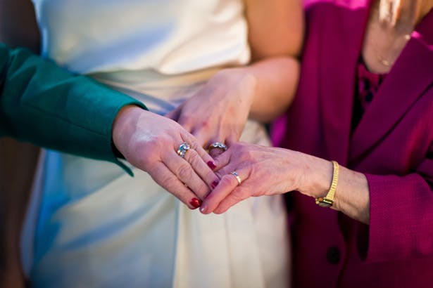 Bride, her mum and gran with their wedding rings | 3 generations of married women | Abigail and Chris's Real Christmas Wedding | Confetti.co.uk